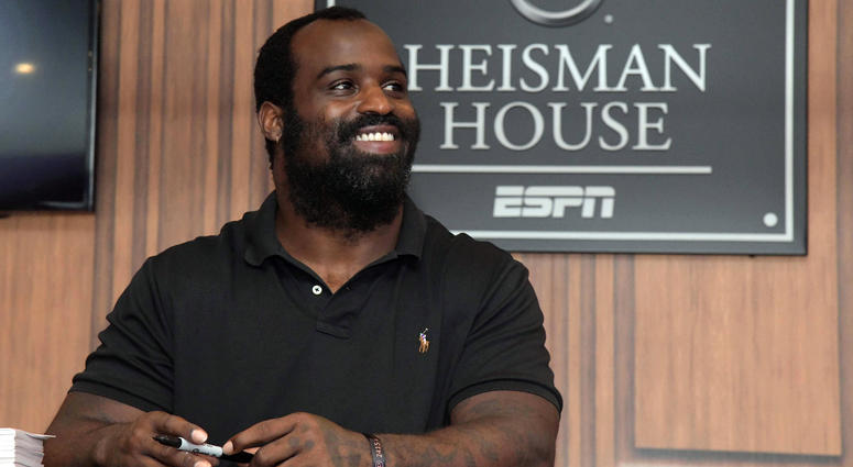 Sep 15, 2018; Austin, TX, USA; Texas Longhorns former running back and 1998 Heisman Trophy winner Ricky Williams signs autographs at the ESPN Heisman House at Darrell K Royal-Texas Memorial Stadium. Mandatory Credit: Kirby Lee-USA TODAY Sports