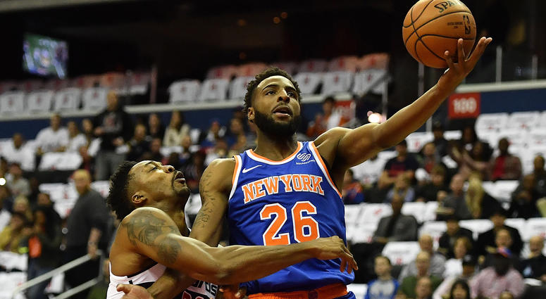 Nov 4, 2018; Washington, DC, USA; New York Knicks center Mitchell Robinson (26) is fouled by Washington Wizards center Dwight Howard (21) during the first half at Capital One. Mandatory Credit: Brad Mills-USA TODAY Sports