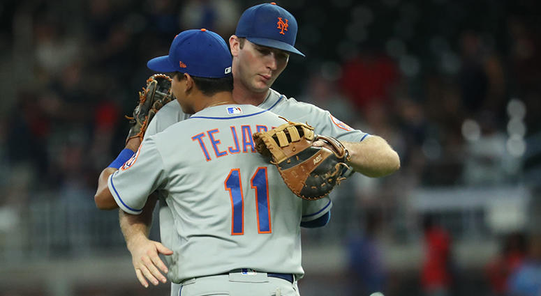 Ruben Tejada and Pete Alonso hug it out
