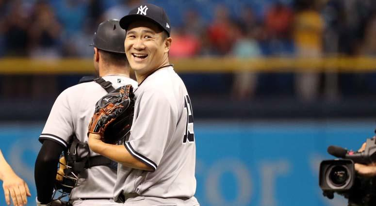 Yankees pitcher Masahiro Tanaka smiles after pitching a complete-game 3-hitter against the Tampa Bay Rays on July 24, 2018, at Tropicana Field in St. Petersburg, Florida.