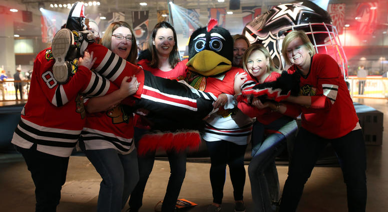 Jan 29, 2016; Nashville, TN, USA; The Chicago Blackhawks mascot interacts with a group of fans during the fan fair for the 2016 NHL All Star Game at Bridgestone Arena. Mandatory Credit: Aaron Doster-USA TODAY Sports