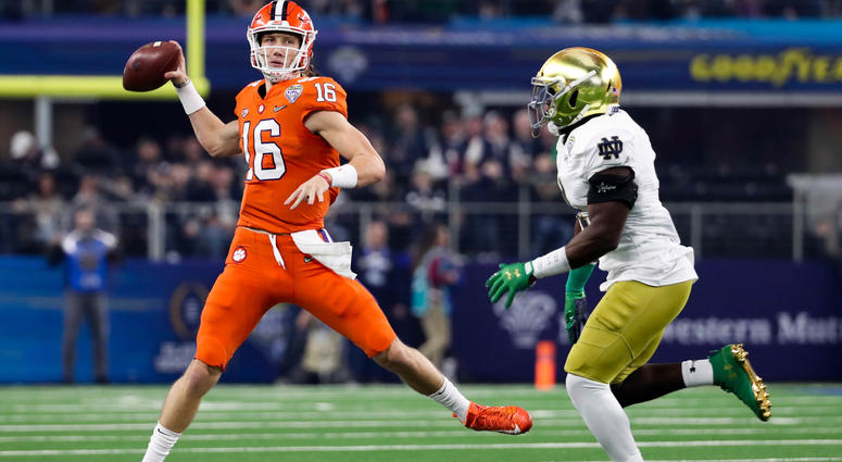 Trevor Lawrence (16) looks to pass as Notre Dame Fighting Irish linebacker Te'von Coney (4) closes in during the first quarter in the 2018 Cotton Bowl college football playoff semifinal game at AT&T Stadium. Mandatory Credit: Kevin Jairaj-USA TODAY Sports