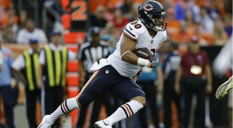 Trey Burton runs the ball in the first quarter against the Denver Broncos at Broncos Stadium at Mile High.