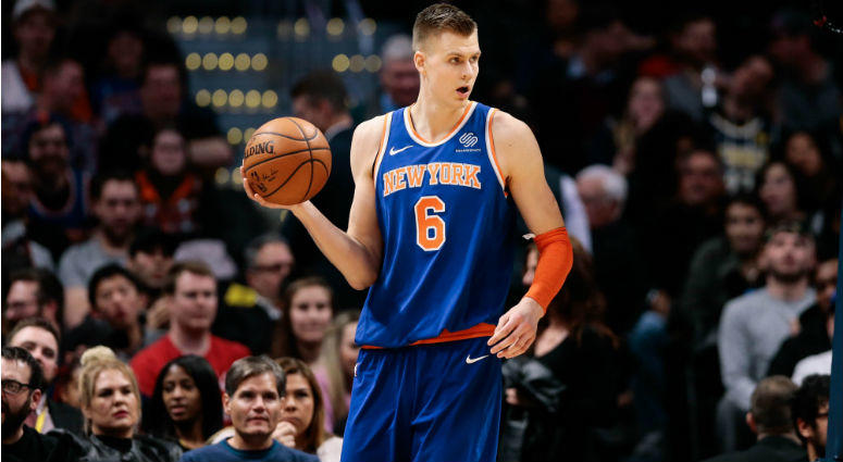 Kristaps Porzingis controls the ball in the fourth quarter against the Denver Nuggets at the Pepsi Center in Denver, CO.