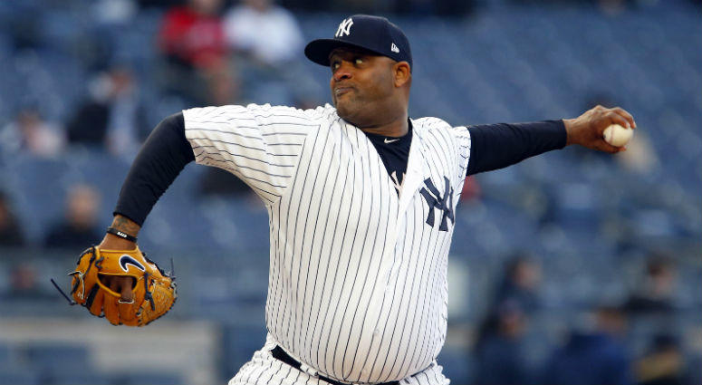 New York Yankees starting pitcher CC Sabathia delivers a pitch against Toronto Blue Jays in the first inning at Yankee Stadium.