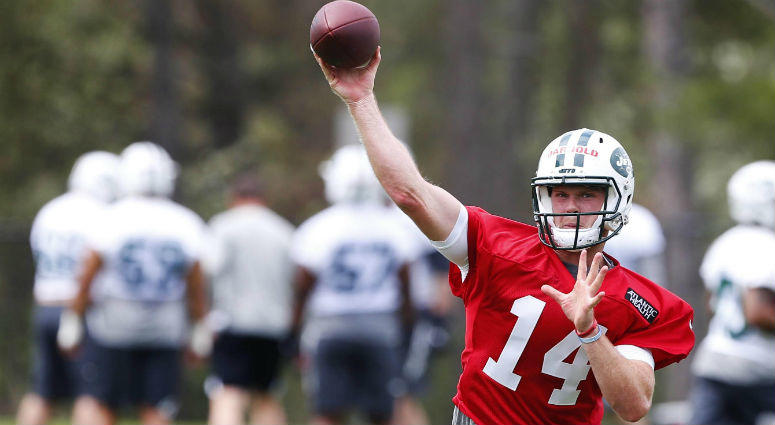 New York Jets quarterback Sam Darnold (14) throws the ball during New York Jets rookie mini camp at Atlantic Health Training Center.