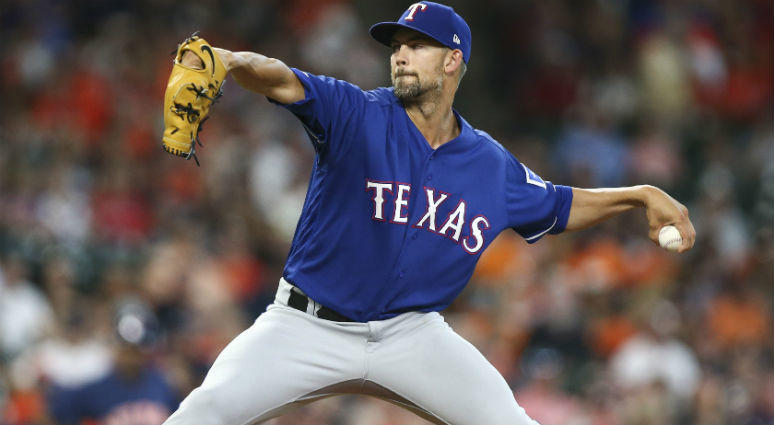 Mike Minor delivers a pitch during the first inning against the Houston Astros at Minute Maid Park.