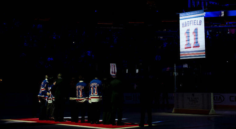 The banner for Vic Hadfield is raised during the jersey retirement for Vic Hadfield at Madison Square Garden.