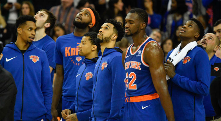 New York Knicks players look up at the videotron while the officials decide on the timing of the final basket during the fourth quarter of the game against the Washington Wizards at The O2 Arena.