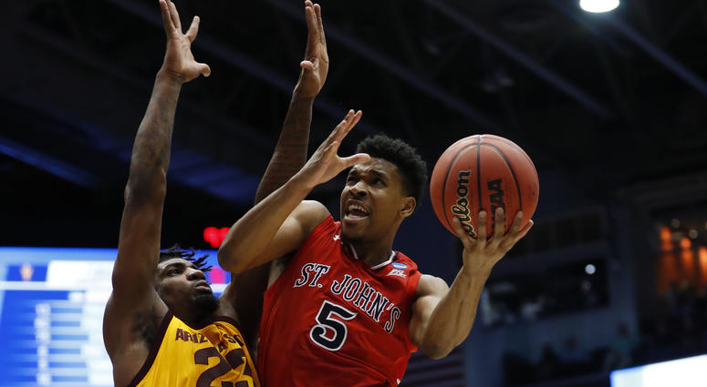 St. John's Red Storm guard Justin Simon (5) goes to the basket defended by Arizona State Sun Devils forward Romello White (23) in the first half in the First Four of the  NCAA Tournament on March 20, 2019, in Dayton, Ohio.