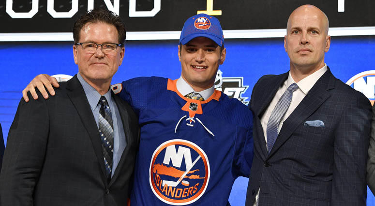 Islanders' first-round draft pick Oliver Wahlstrom poses with  with team representatives after being selected as the 11th overall pick.