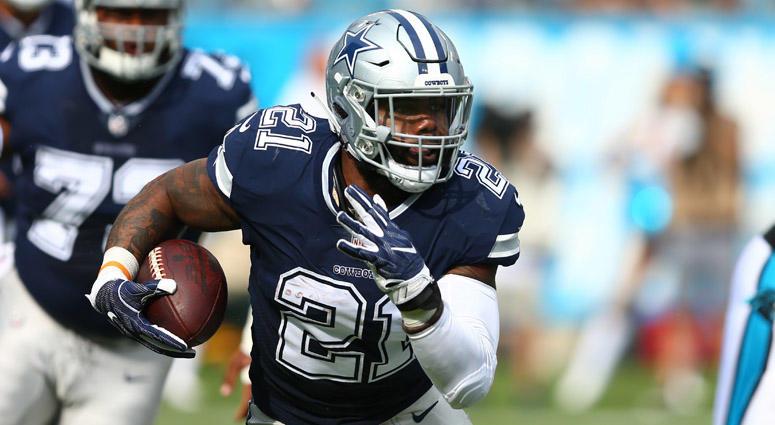 Cowboys running back Ezekiel Elliott runs the ball against the Carolina Panthers on Sept. 9, 2018, at Bank of America Stadium in Charlotte, North Carolina.