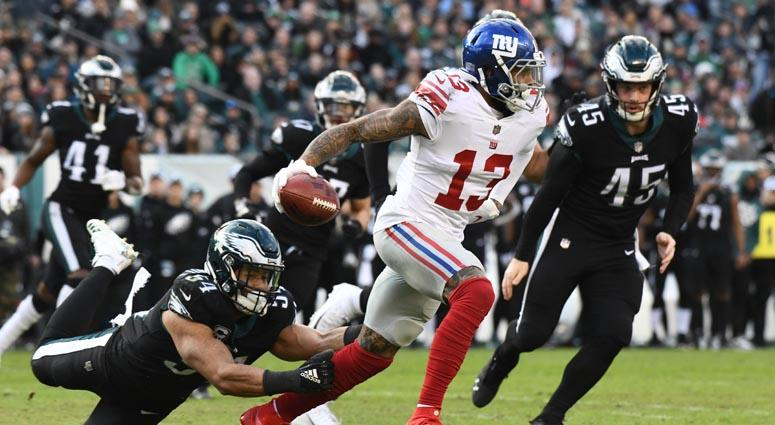 686083cb9 Giants wide receiver Odell Beckham Jr escapes a tackle by Eagles linebacker  Kamu Grugier-Hill