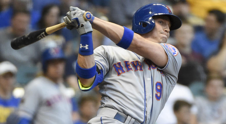 The Mets' Brandon Nimmo hits a triple against the Milwaukee Brewers on April 24, 2018, at Miller Park.