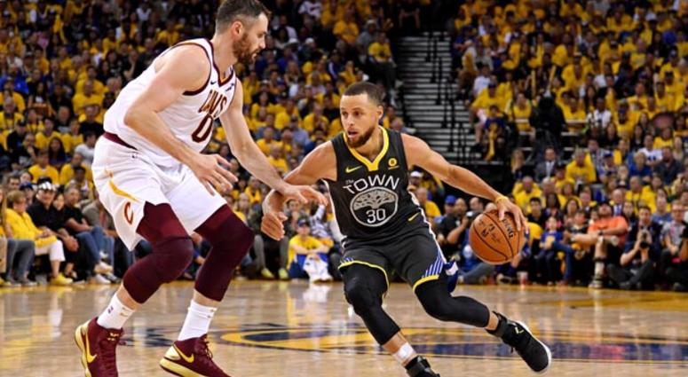 d40473cad2bb Warriors guard Stephen Curry drives to the basket against Cavaliers center Kevin  Love during the fourth