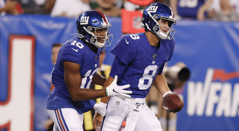 New York Giants quarterback Daniel Jones (8) celebrates with Bennie Fowler (18) after they connected for a touchdown during the first half of a preseason NFL football game against the New York Jets on Thursday, Aug. 8, 2019, in East Rutherford, N.J.