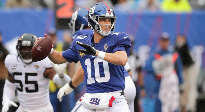 Giants quarterback Eli Manning passes the ball in front of Jacksonville Jaguars defensive end Lerentee McCray on Sept. 9, 2018, at MetLife Stadium.