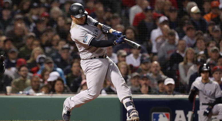 Yankees catcher Gary Sanchez (24) hits an 3-RBI home run during the seventh inning against Boston Red Sox in game two of the 2018 ALDS playoff baseball series at Fenway Park.
