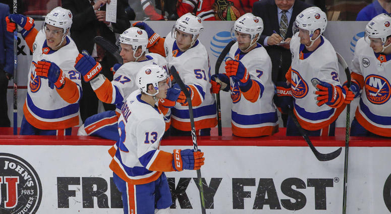 Islanders center Mathew Barzal (13) celebrates with teammates after scoring against the Blackhawks on Jan. 22, 2019, at United Center in Chicago.