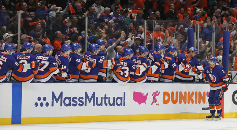 UNIONDALE, NEW YORK - APRIL 12: Jordan Eberle #7 of the New York Islanders celebrates his game-winning goal against the Pittsburgh Penguins in Game Two of the Eastern Conference First Round during the 2019 NHL Stanley Cup Playoffs at NYCB Live's Nassau Co