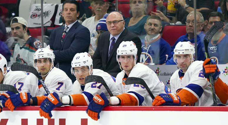 Islanders coach Barry Trotz looks on from behind the bench against the Carolina Hurricanes on Oct. 4, 2018, at PNC Arena in Raleigh, North Carolina.