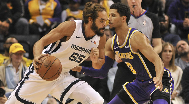 Grizzlies center Joakim Noah dribbles the ball as Lakers guard Josh Hart defends on Dec. 8, 2018, at the FedExForum in Memphis.