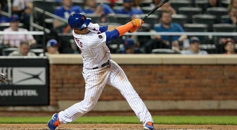 Mets center fielder Juan Lagares hits a two-run single against the Toronto Blue Jays during the fourth inning on May 15, 2018, at Citi Field.