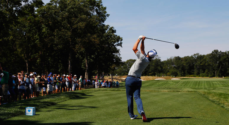 Justin Rose hits his tee shot on the 12th hole during the third round of The Barclays on the Black Course at Bethpage State Park on Aug. 27, 2016.