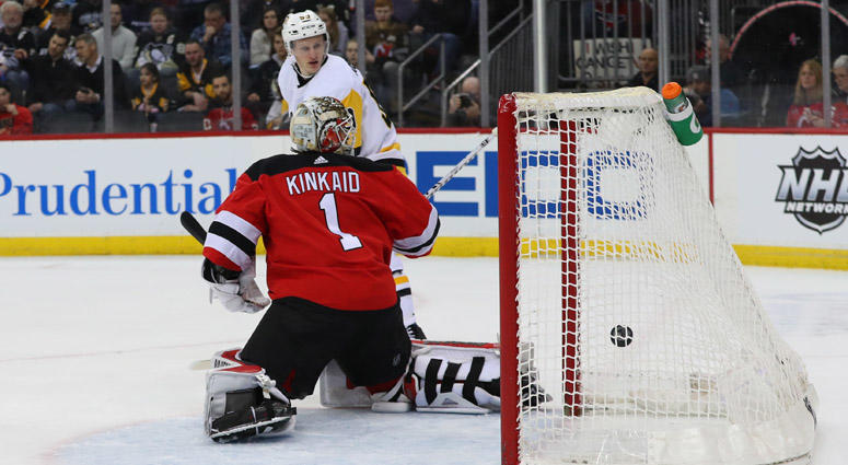 Penguins center Nick Bjugstad (not shown) scores a goal on New Jersey Devils goaltender Keith Kinkaid on Feb. 19, 2019, at the Prudential Center.