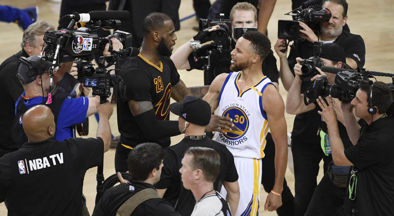 Golden State Warriors guard Stephen Curry greets Cleveland Cavaliers forward LeBron James after Game 5 of the NBA Finals on June 13, 2018, at Oracle Arena in Oakland, California.