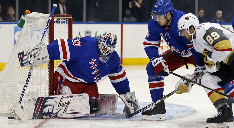 Rangers goaltender Henrik Lundqvist makes a save in front of Vegas Golden Knights right wing Alex Tuch on Dec. 16, 2018, at Madison Square Garden.