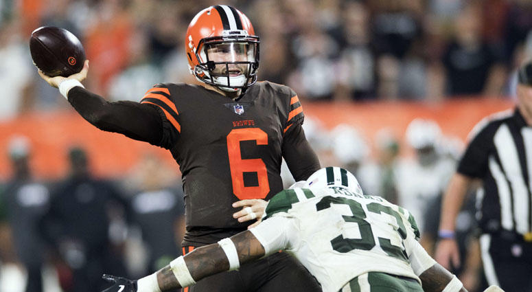 0a17b9ee696 Browns quarterback Baker Mayfield throws a pass under pressure against the  Jets on Sept. 20