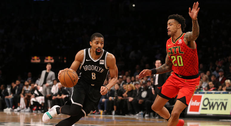 Nets point guard Spencer Dinwiddiedrives against Hawks power forward John Collins on Jan. 9, 2019, at Barclays Center.