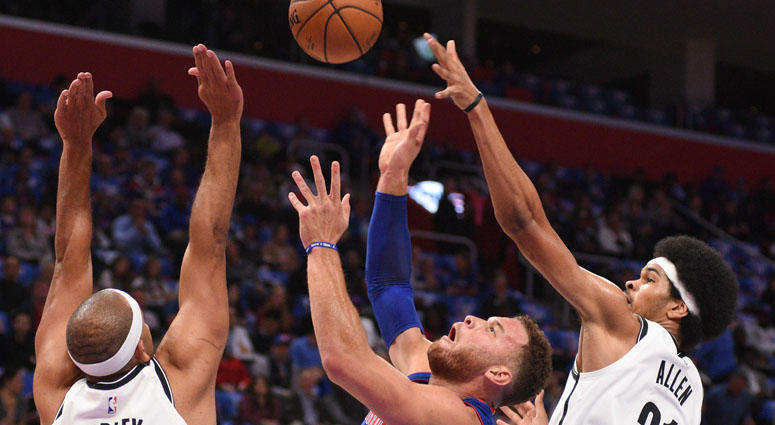 Detroit Pistons forward Blake Griffin (23) goes to the basket as Brooklyn Nets forward Jared Dudley (6) and center Jarrett Allen defend on Oct. 16, 2018, at Little Caesars Arena in Detroit.