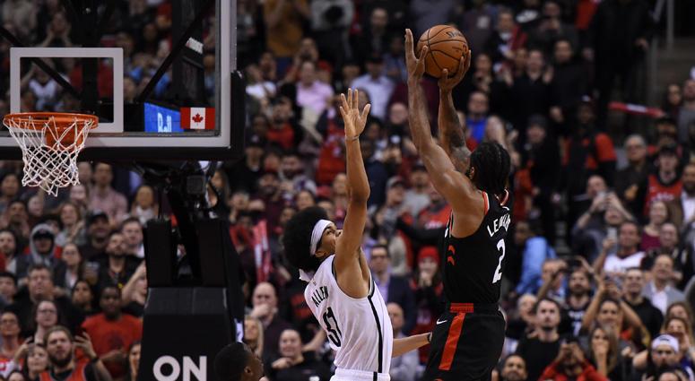 Raptors forward Kawhi Leonard shoots the game-winning basket over Nets center Jarrett Allen at Scotiabank Arena in Toronto.
