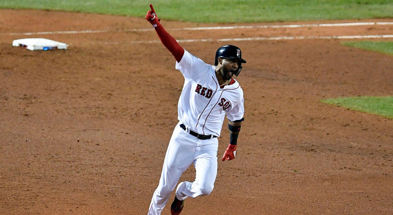 Red Sox pinch hitter Eduardo Nunez celebrates after hitting a three-run home run against the Los Angeles Dodgers in Game 1 of the World Series on Oct. 23, 2018, at Fenway Park in Boston.