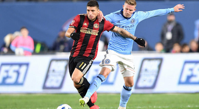 NYCFC midfielder Alexander Ring attempts to steal the ball from Atlanta United midfielder Eric Remedi on Nov. 4, 2018, at Yankee Stadium.