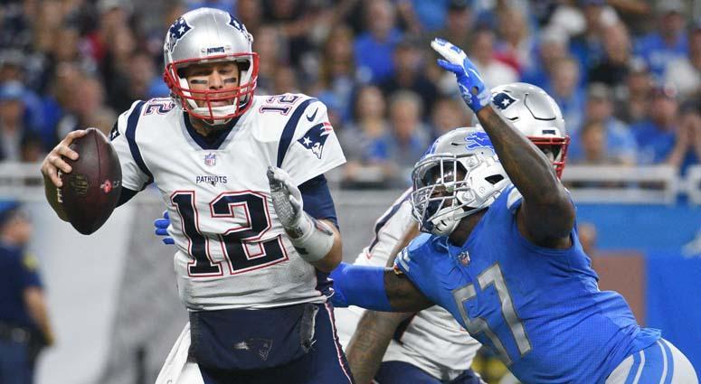 Lions linebacker Eli Harold sacks Patriots quarterback Tom Brady on Sept. 23, 2018, at Ford Field in Detroit.