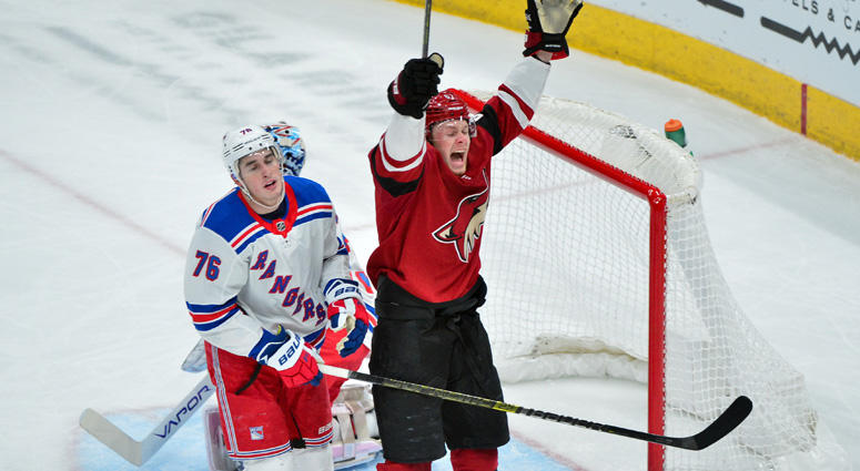 Coyotes left wing Lawson Crouse and Rangers defenseman Brady Skjei react after a goal by Arizona right wing Mario Kempe (not pictured) in the first period on Jan. 6, 2019, at Gila River Arena in Glendale, Arizona.