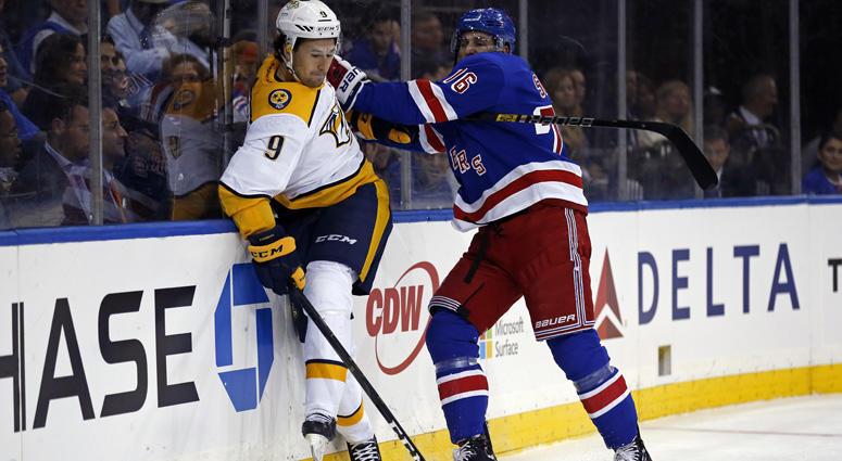 Rangers defenseman Brady Skjei checks Predators left wing Filip Forsberg on Oct. 4, 2018, at Madison Square Garden.