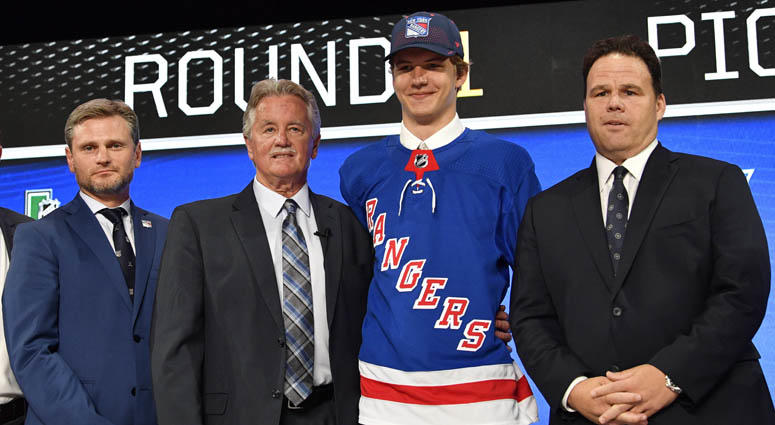 Vitali Kravtsov poses for a photo with team representatives after being selected as the ninth overall pick by the New York Rangers in the first round of the 2018 NHL Draft at American Airlines Center in Dallas.