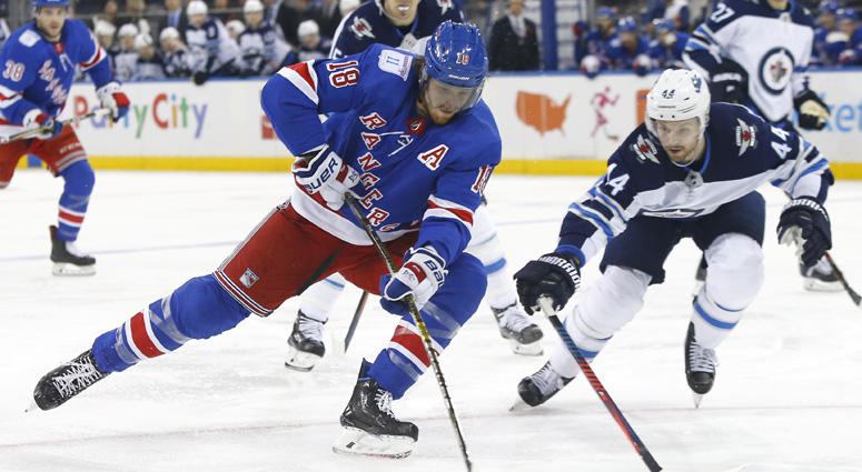 New York Rangers defenseman Marc Staal controls the puck against Winnipeg Jets defenseman Josh Morrissey on Dec. 2, 2018, at Madison Square Garden.
