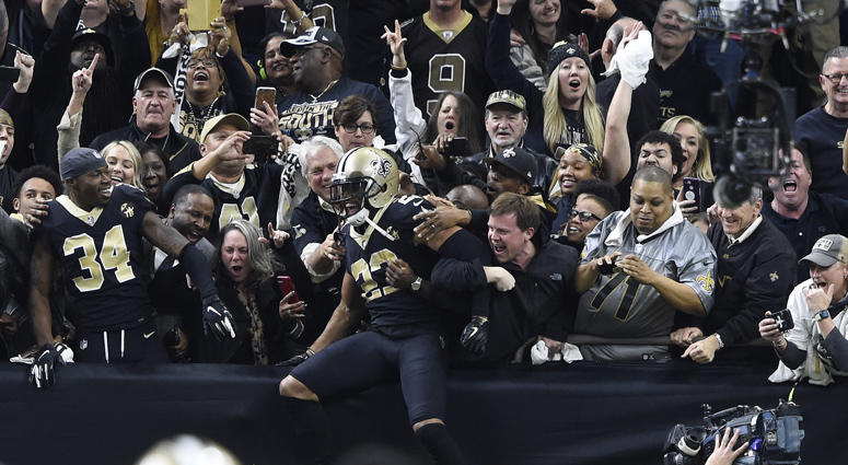 Saints cornerback Marshon Lattimore celebrates with fans after intercepting a pass against the Philadelphia Eagles during the fourth quarter of an NFC divisional playoff game on Jan. 13, 2019, at the Mercedes-Benz Superdome in New Orleans.