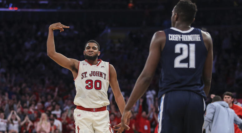 St. John s Red Storm forward LJ Figueroa celebrates after hitting a 3-point shot in the second half against the Villanova Wildcats on Feb. 17, 2019, at Madison Square Garden.