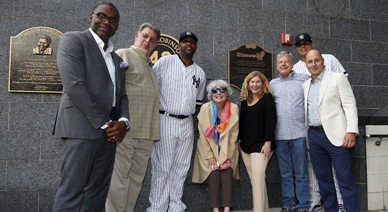 Representatives of the Stonewall Inn and New York Yankees pose for a photograph at the newly unveiled plaque in Monument Park honoring the 50th anniversary of the Stonewall Inn uprising.