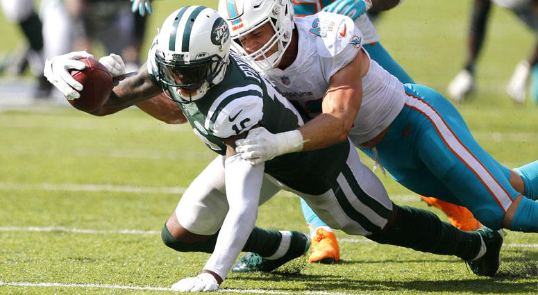 73e9f5343d1 Jets wide receiver Terrelle Pryor is tackled after a catch by Dolphins  linebacker Kiko Alonso on