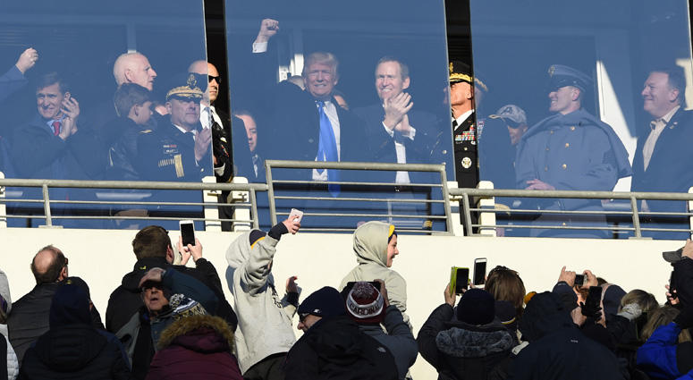 Donald Trump waves to the crowd from a suite during the Army-Navy football game at M&T Bank Stadium on Dec. 10, 2016, in Baltimore.