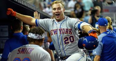 Mets first baseman Pete Alonso celebrates in the dugout after hitting a three-run homer against the Marlins on April 1, 2019, at Marlins Park in Miami.
