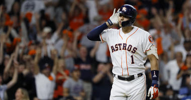 Houston Astros shortstop Carlos Correa celebrates after his walk-off home run against the New York Yankees during the 11th inning in Game 2 of baseball's American League Championship Series Monday, Oct. 14, 2019, in Houston