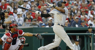 Aaron Hicks hits a two run home run against the Washington Nationals in the fifth inning at Nationals Park.
